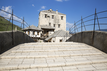 stone stairs of Old Bridge or Stari Most crossing the Neretva River, Mostar, Bosnia and Herzegovina. The Old Bridge was destroyed on 9 November 1993 by Croat military forces during the Croat?Bosniak War. The area is a UNESCO World Heritage Site.