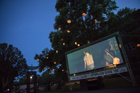 Amsterdam, The Netherlands - August 11 2018: open air screening of Cuban film Sergio and Serguei at De Troppen garden during World Cinema Amsterdam, a world film festival held from 11 to 25/08/2018 報道画像
