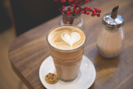 View of a delicious cappuccino or cafe latte with a milk heart shape pattern