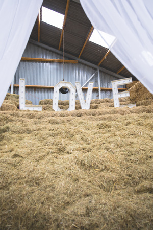 LOVE letters set up on a haystack at wedding location
