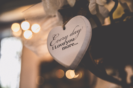 wedding decoration, wooden heart with a love text saying Every day I love you more