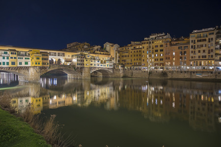 Night view over the Arno River in Florence with Ponte Vecchio