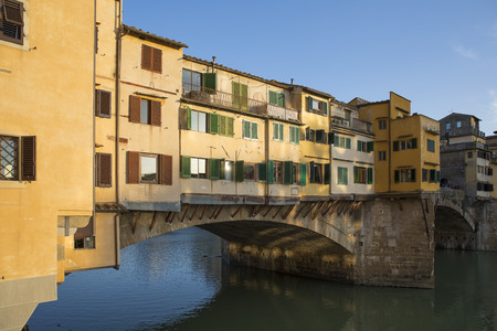Sunny view on the Arno River and Ponte Vecchio in Florence, Italy