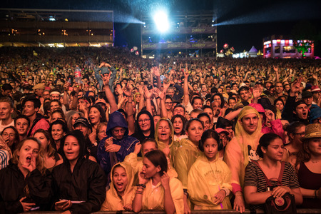 Nyon, Switzerland - 26 July 2019 : crowd od audience cheering in front of  concert of French rap singer Soprano Sajtókép
