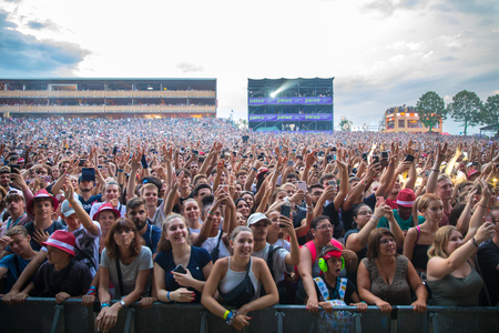 Nyon, Switzerland - 26 July 2019 :  crazy crowd of young poeple cheering and dancing at concert of Congolese-Belgian rap singer Damso Sajtókép