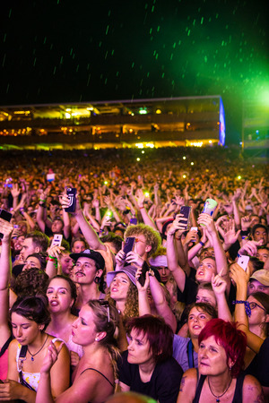Nyon, Switzerland - 25 July 2019 : crowd od audience singing and cheering in front of concert of  French rap singer Lomepal