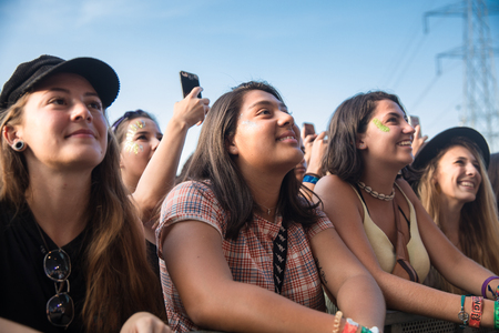 Nyon, Switzerland - 23 July 2019 : group of girls in the audience crowed cheering during concert of Australian singer-songwriter and multi-instrumentalist Tash Sultana at Paleo Festival