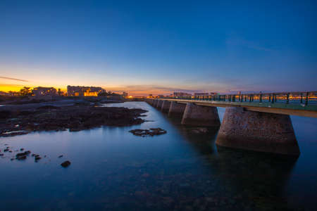 Entrance of Les Sables D'Olonne harbour taken from La Chaume, with it piers and lighthouse at sunset, Vendee, France
