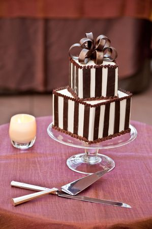 layer cake: A chocolate wedding cake with cutting knife Stock Photo