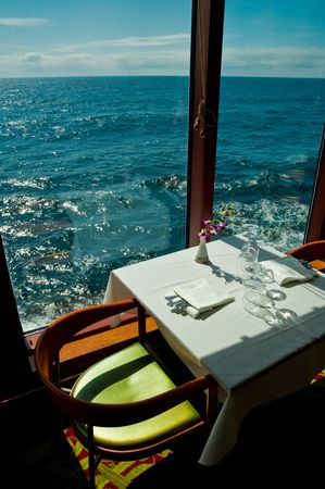 dinner cruise: A dinning table for two by the sea