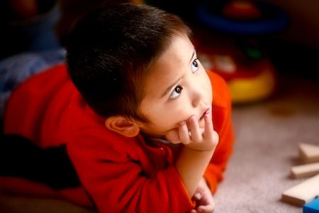 An Asian boy gazing into the sky