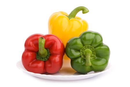 Three colorful peppers on the plate Stock Photo