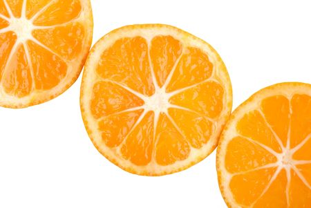 Three tasty tangerine slices isolated on white