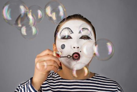 Mime with bubbles on grey background Stock Photo