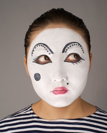 Asian mime on brown background