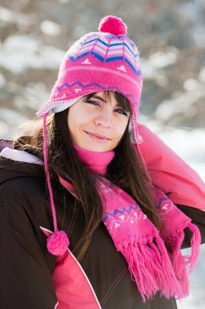 Preatty winter woman on snow background in sunny day