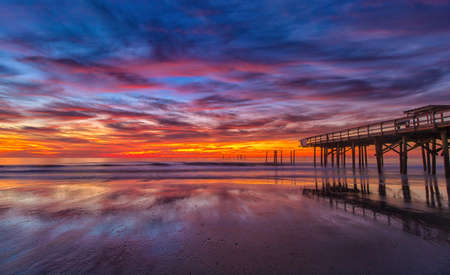 Pre-dawn colorful sky at the damaged Springmaid Pier in Myrtle Beach, S.C.