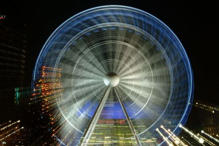 Night time ferris wheel photo