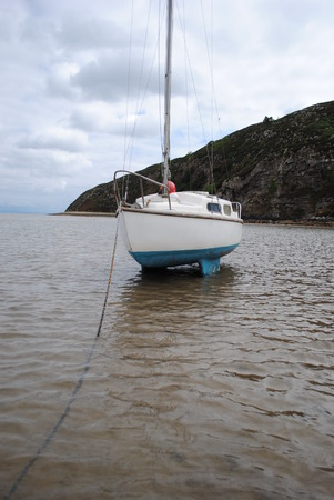 anchoring: Sailing Boat on the Water in low tide