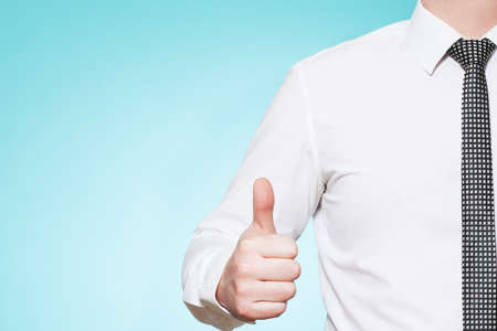 Man wearing shirt and tie thumbs up photo