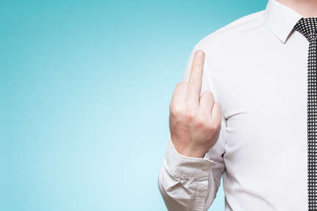Man wearing shirt and tie shows middlefinger photo