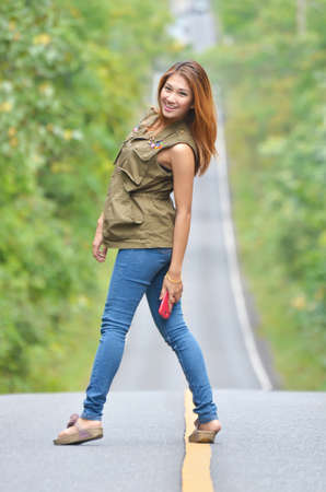 khaoyai: Girl On Forest road in Thailand Stock Photo