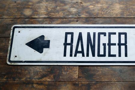 Vintage Ranger Station Sign on Old Barn Wood Floor