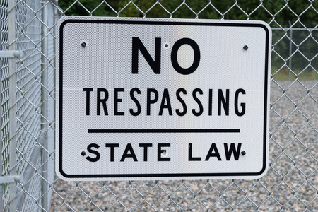 trespassing: No Trespassing Sign on Security Fence Stock Photo