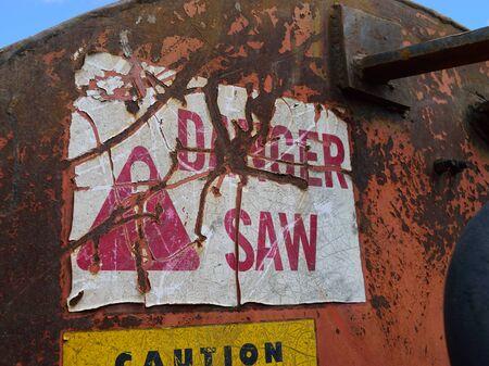 slasher: Warning Label on Log Cutoff Slasher Saw Stock Photo