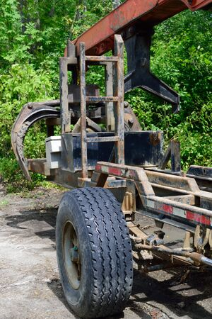 Log Loader Trailer and Grapple Stock Photo