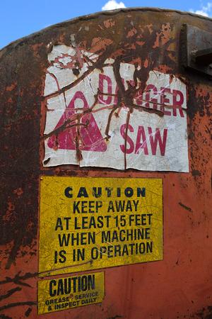 cutoff: Warning Labels on Log Cutoff Slasher Saw Stock Photo