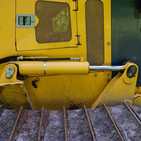 tilt: Side View of Bulldozer Tilt Cylinder and Track