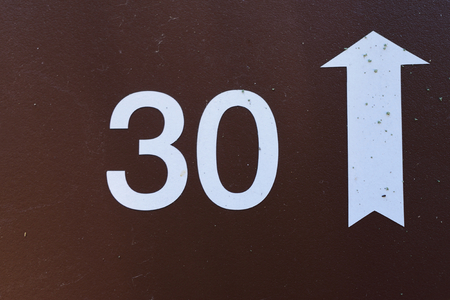 Thirty with Arrow Sign