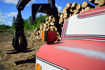 grapple: Red and White Log Loader Truck