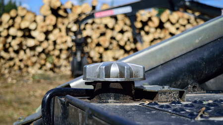 Diesel Fuel Cap on Log Skidder with Loader in Background