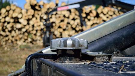populus tremuloides: Diesel Fuel Cap on Log Skidder with Loader in Background