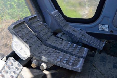 controls: Excavator Foot Controls Stock Photo