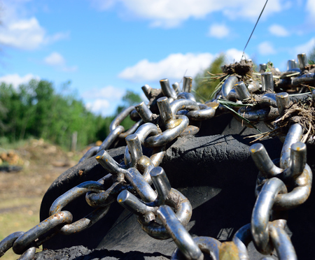 Skidder Tire and Chains on Landing