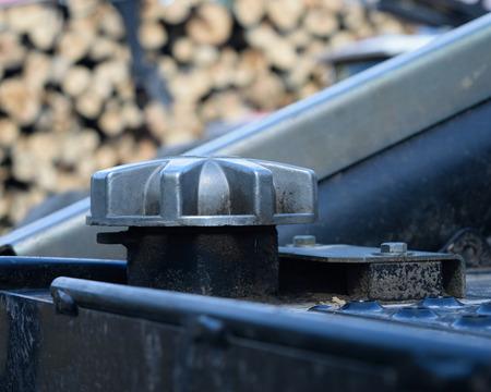 populus tremuloides: Diesel Fuel Cap on Skidder Stock Photo