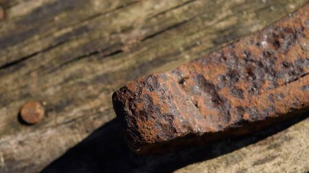barnwood: Closeup of Old Rusty Horseshoe on Barnwood