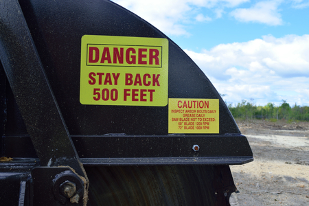 carbide: Warning Labels on Log Slasher Saw in Summer Stock Photo