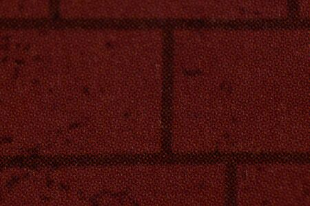 Closeup Detail of Red Brick from Newspaper