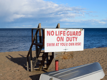 life guard stand: Lake Superior Lifeguard Station and Boat in Fall Stock Photo