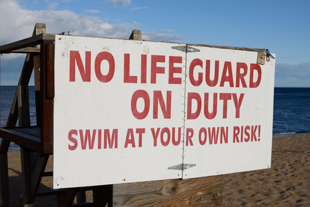 life guard stand: Sign Stating  No Lifeguard On Duty Swim At Your Own Risk!