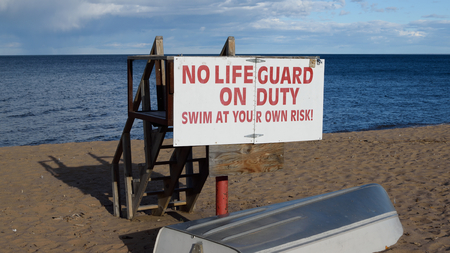 life guard stand: Vacant Lifeguard Station and Boat on Lake Superior