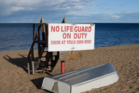 life guard stand: Empty Lifeguard Station and Boat on Lake Superior Shore