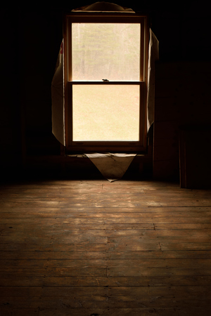 attic: Sunlight Through Window of Abandoned House Stock Photo