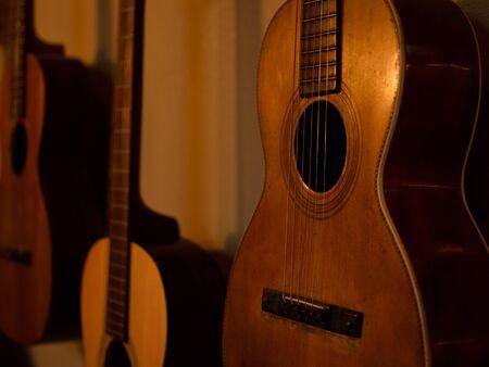 bluegrass: Three Parlor Guitars on Wall
