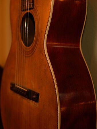 parlor: Parlor Guitar on Wall