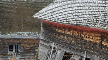 Worn and Weathered Barns in Winter Stock Photo
